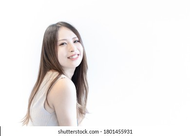 Young woman photographed on a white background