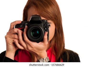Young woman photographer with camera in her hand