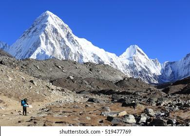young woman photographer at the himalaya mountains