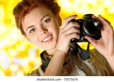 Young woman photographer outdoors portrait.