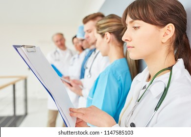 Young woman as physician apprenticeship reads patient act