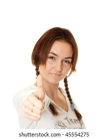 young woman with pigtails shows the sign okay, focus on finger, isolated on white