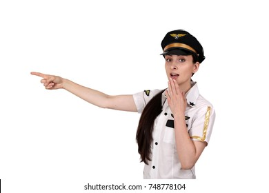 Young woman in pilot uniform points with finger surprised isolated on white background