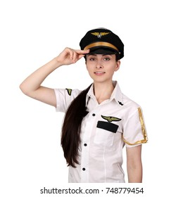 Young woman in pilot uniform salutes smiling isolated on white background