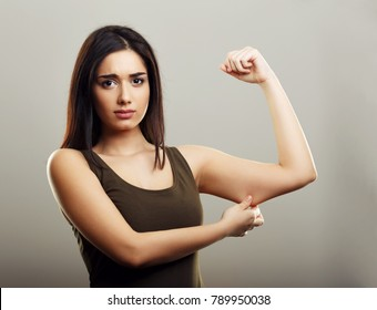 Young woman pinching arm fat flabby skin