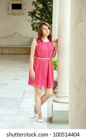 Young woman in pink dress in a Livadia Palace. Crimea, Ukraine