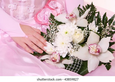young woman in pink dress with white flowers