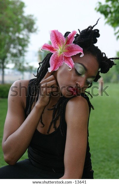 young woman with pink flower