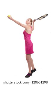 Young woman in pink with tennis racket in her hand serving the ball, on white background