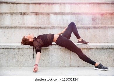 Young woman with pixie hair working out and doing yoga