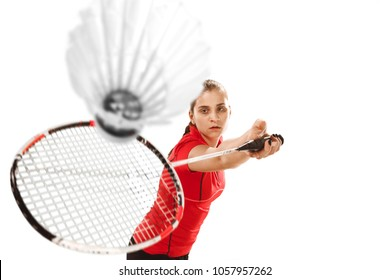 Young woman playing badminton over white studio background. Fit female athlete isolated on white. badminton player in action, motion, movement. attack and defense concept