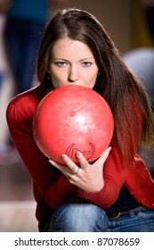a young woman playing bowling