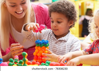 Young woman playing with boy