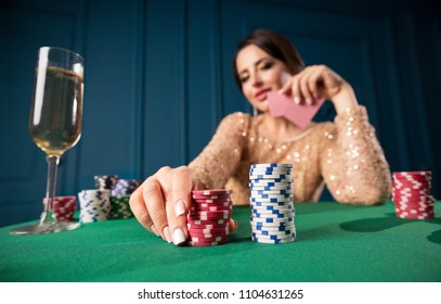 Young woman playing in casino
