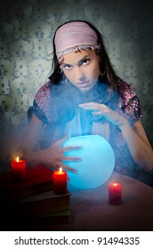 Young woman playing fortune-teller