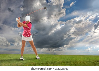 Young woman playing golf on course