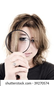 Young woman playing with magnifier