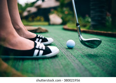 Young woman is playing mini golf. Selective focus