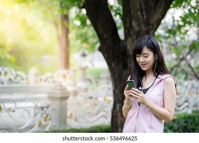 A young woman playing mobile