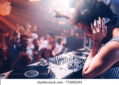 Young woman playing music at the club