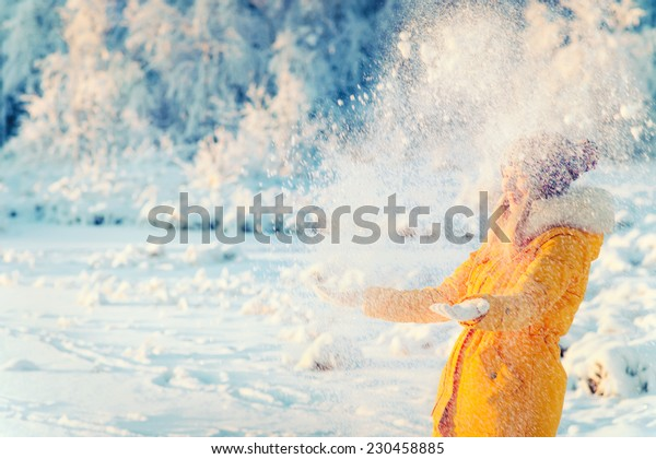Young Woman playing with snow Outdoor Winter Lifestyle happiness emotions nature on background