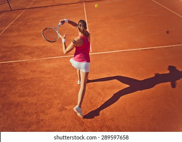 Young woman playing tennis.High angle view.Forehand.