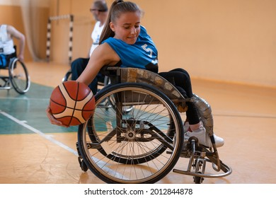 a young woman playing wheelchair basketball in a professional team. Gender equality, the concept of sports with disabilities.