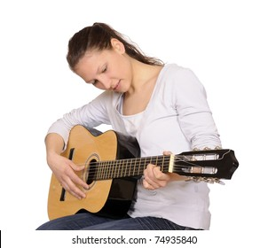 young woman plays guitar