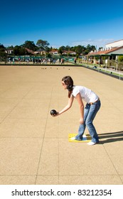 young woman plays lawn bowling in the afternoon (queensland, australia)