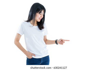 Young woman pointing empty copy space isolated on white. Asian female model