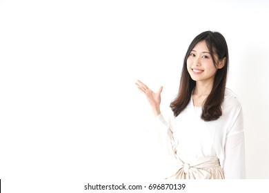 Young woman pointing something with smile