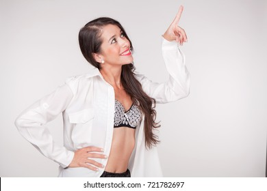 young woman points finger and smiles II