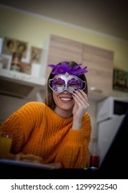 Young woman portrait with carneval mask at home.