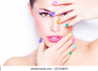 young woman portrait with colorful makeup and nail polish, studio shot