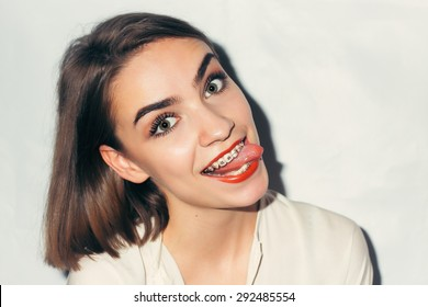 Young woman portrait with dental braces natural