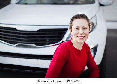 A young woman portrait with her car.
