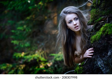 young woman portrait outdoor in the forest