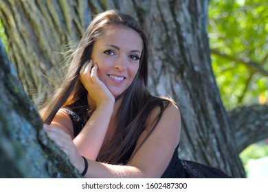 young woman portrait outside under a tree