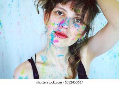 Young woman portrait with paint in her face