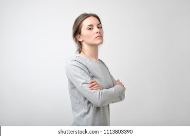 The young woman portrait with proud and arrogant emotions on face. She is self proud and does not care about other people