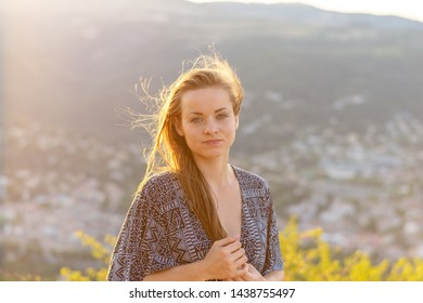 Young woman portrait. Young woman with sexy dress at sunset. Rhone valley in the background.