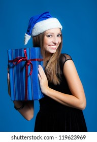 Young woman portrait in studio with presents