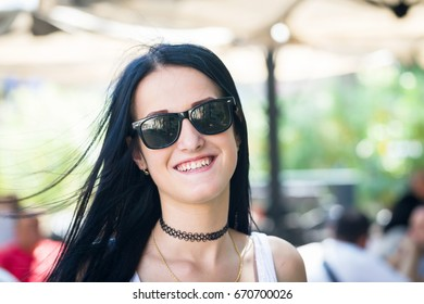young woman portrait in sunglasses in summer outdoor