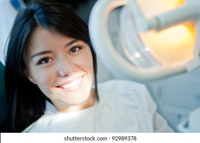 Young woman portrait visiting the dentist and smiling
