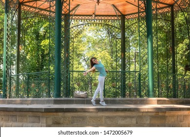 Young woman posing in the beautiful green garden pavilion. Mestsky or City park of Kosice, Slovakia (Slovensko). People, travel and summer holidays concept - Shutterstock ID 1472005679