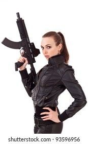 Young woman posing with a guns