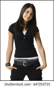 Young woman posing with hands in pockets