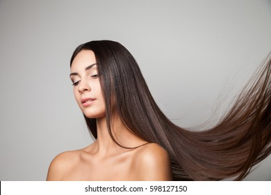 Young woman posing with her gorgeous long flying hair.
