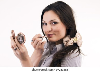 Young woman: posing with makeup tool