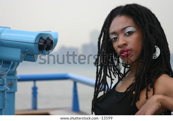 young woman posing near river